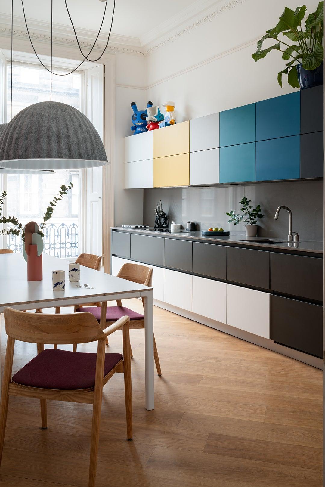 Multicolored kitchen cabinets in Sam Buckley's Edinburgh apartment