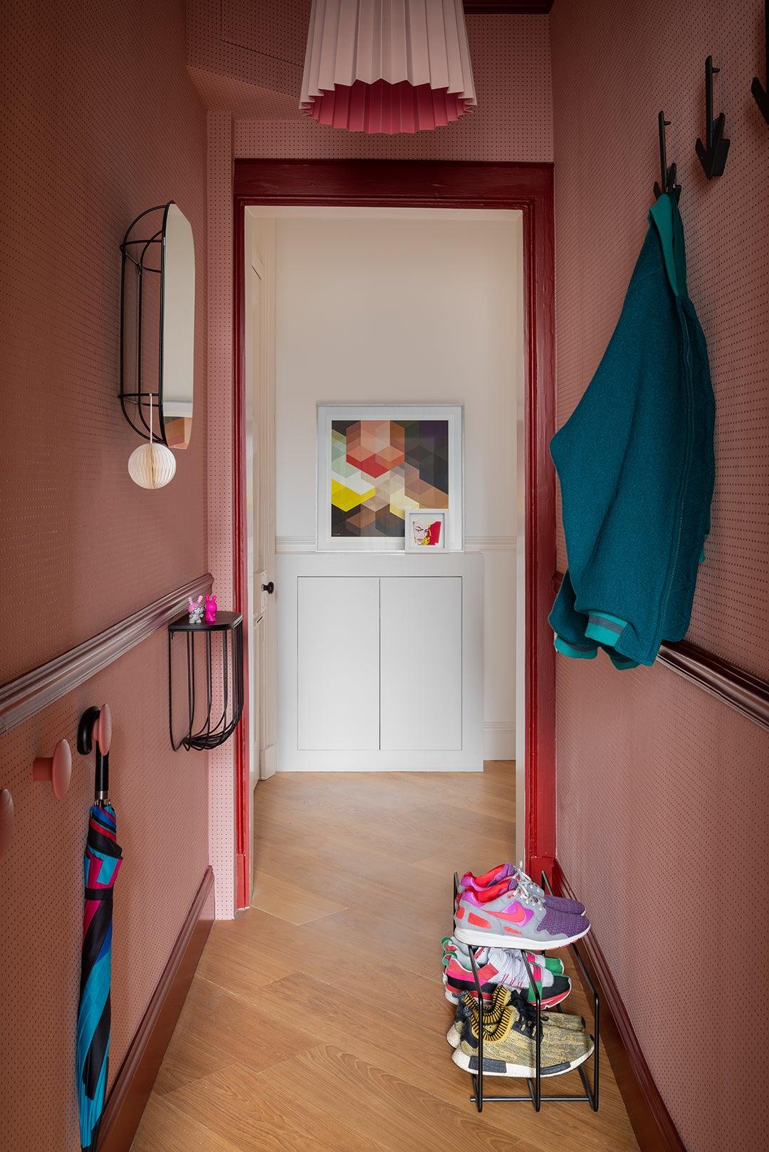 Pink dotted wallpaper in Sam Buckley's Edinburgh apartment