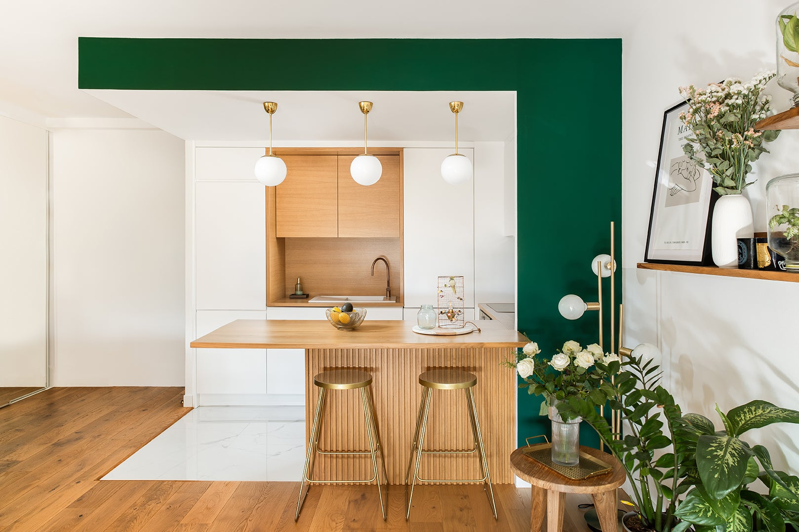 green and white kitchen with bar seating