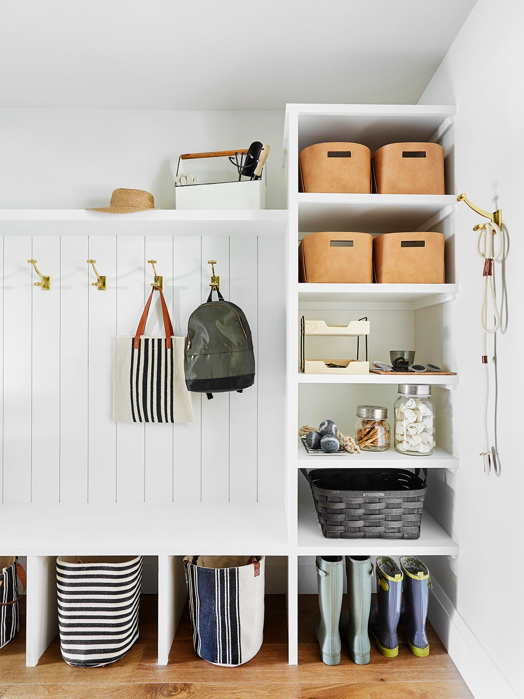 laundry room with backpacks on walls