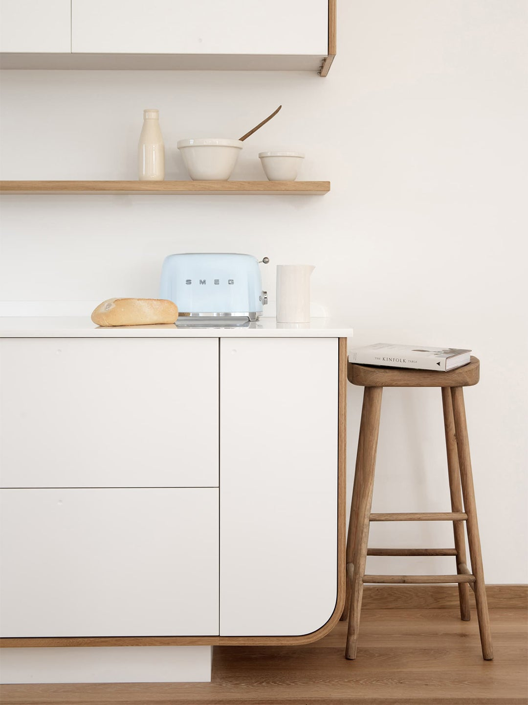white kitchen counter with blue toaster