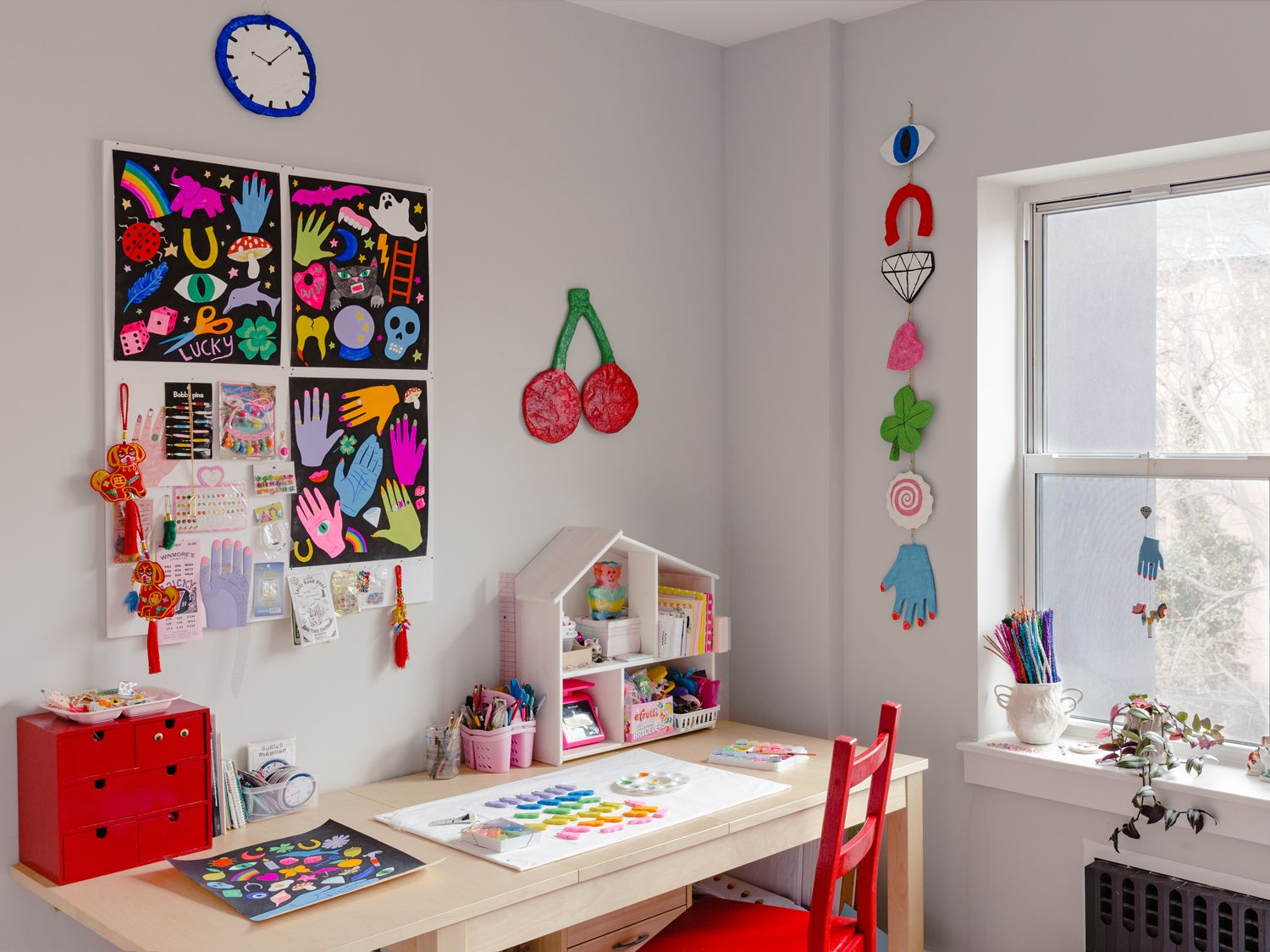 kids desk with art on the walls