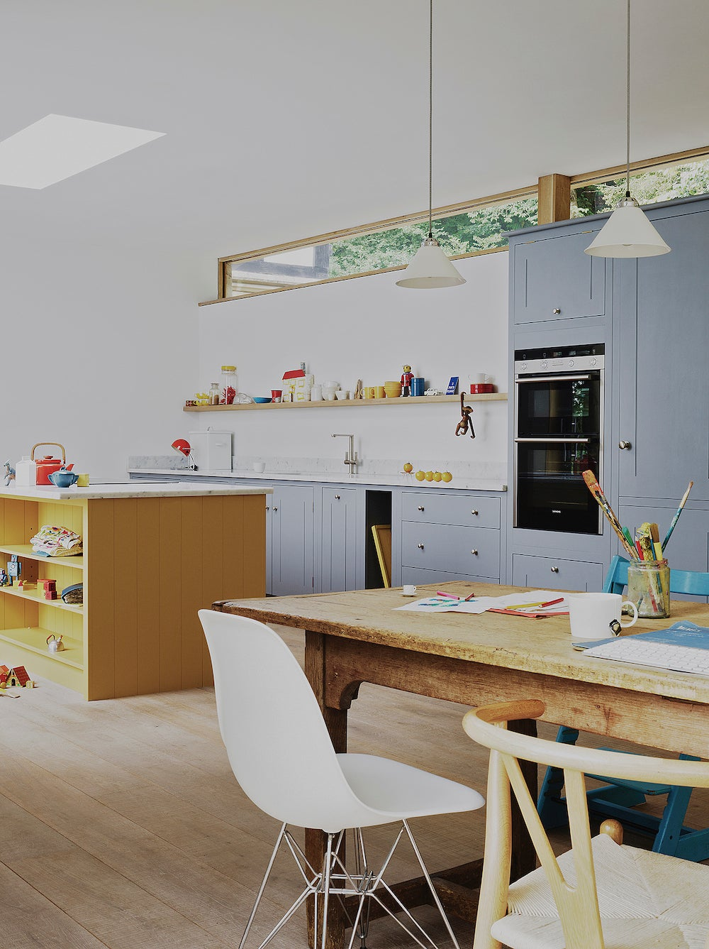 wood kitchen dinging table and gray cabinets
