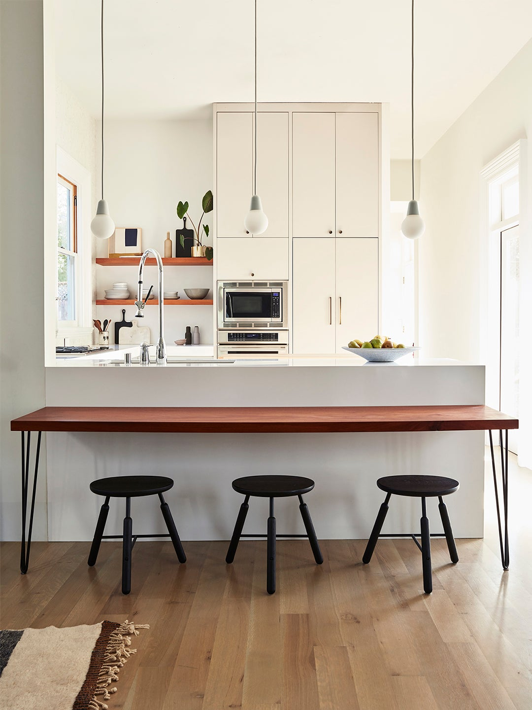 cream colored kitchen with stools at bar