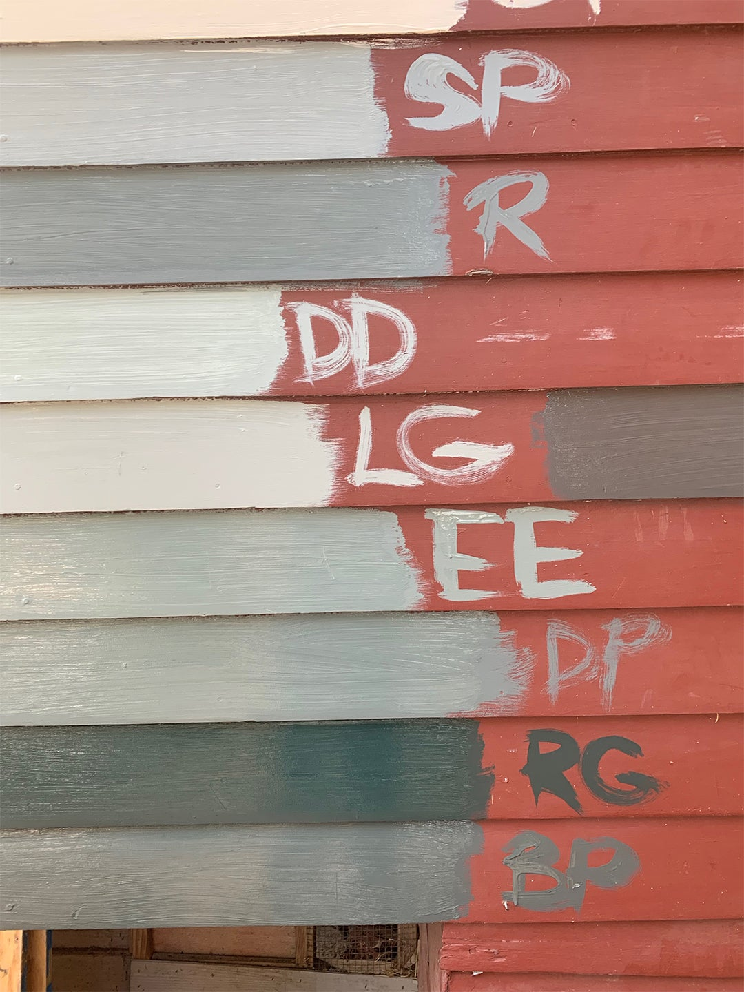 paint swatches on red exterior