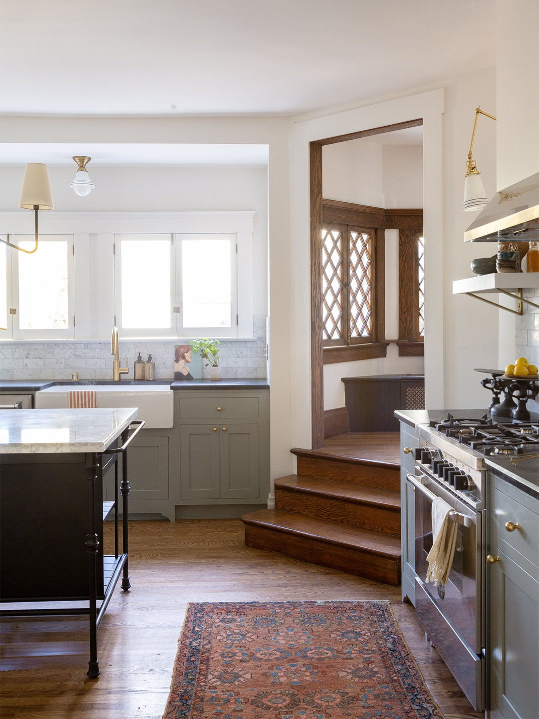 stairs going down into a kitchen