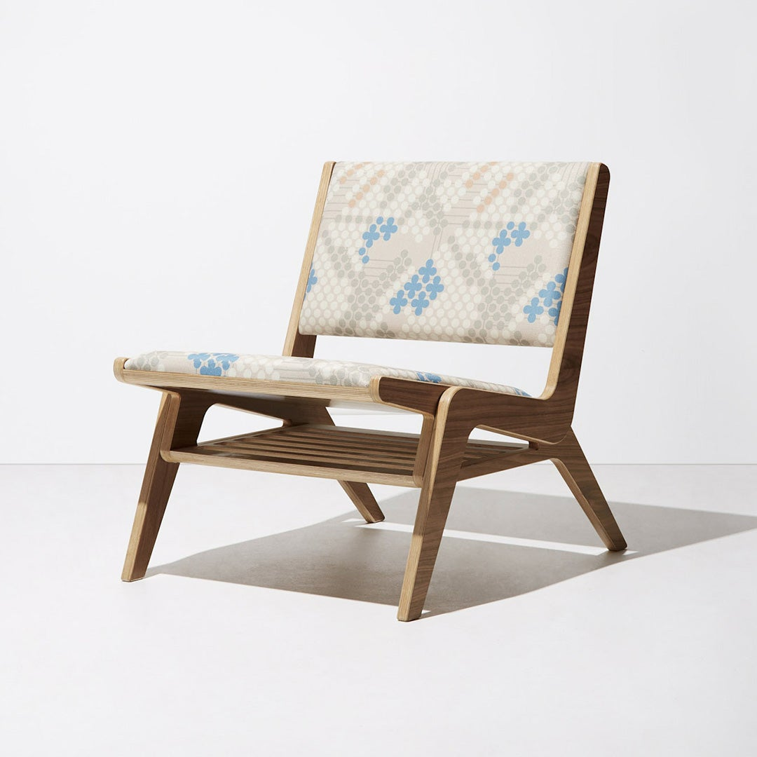 armless wood chair with blue fabric