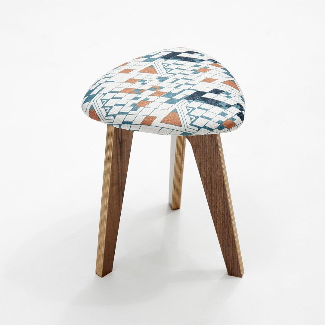 triangular stool with blue and orange triangle fabric