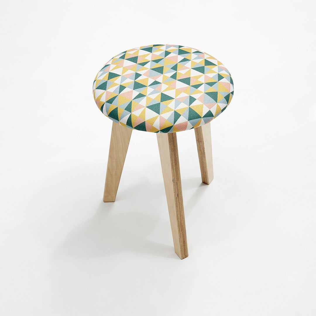 round pink and green stool