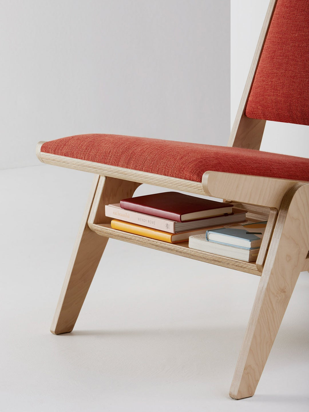 red chair with shelf for books