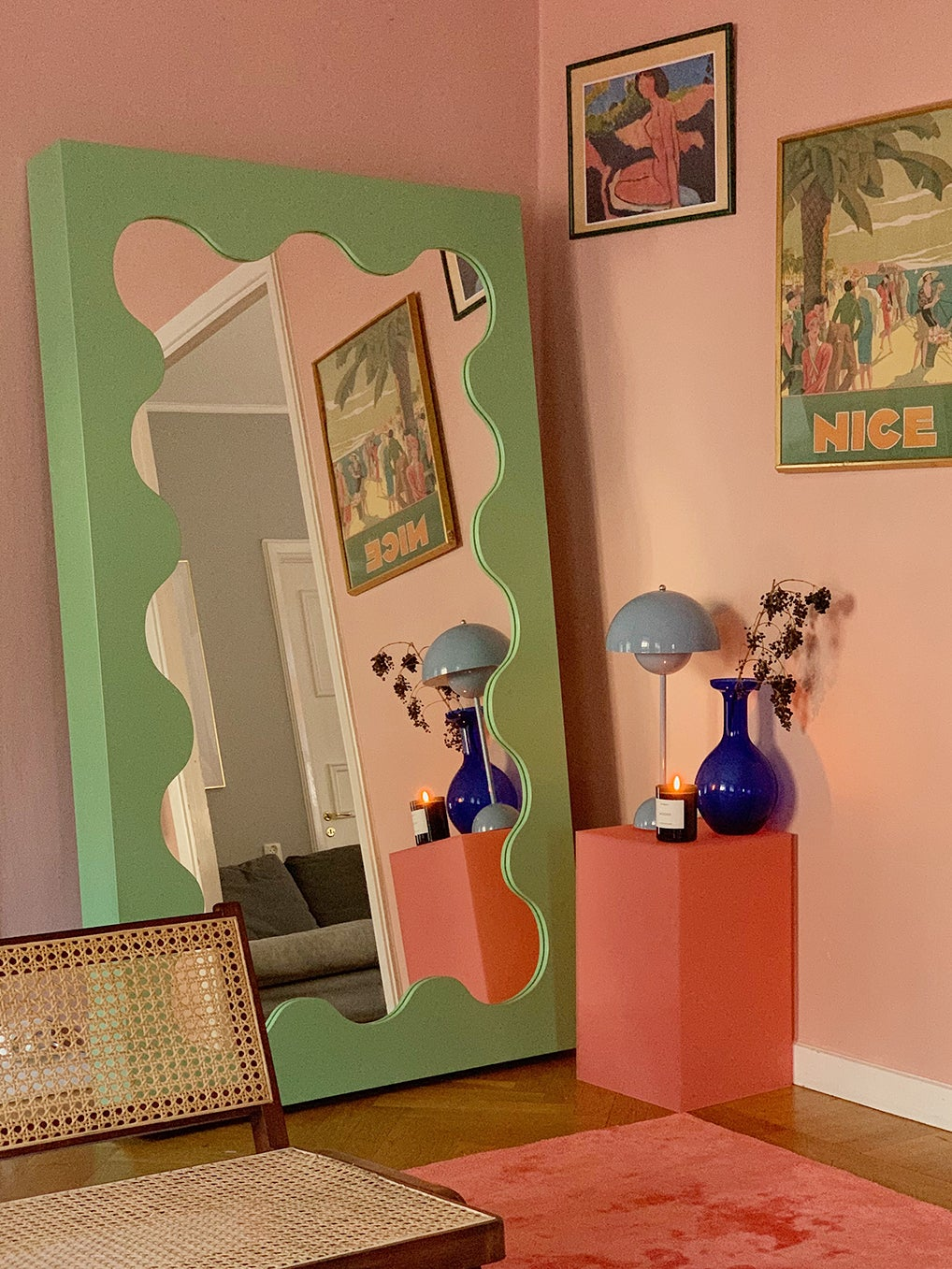 pink room with green mirror