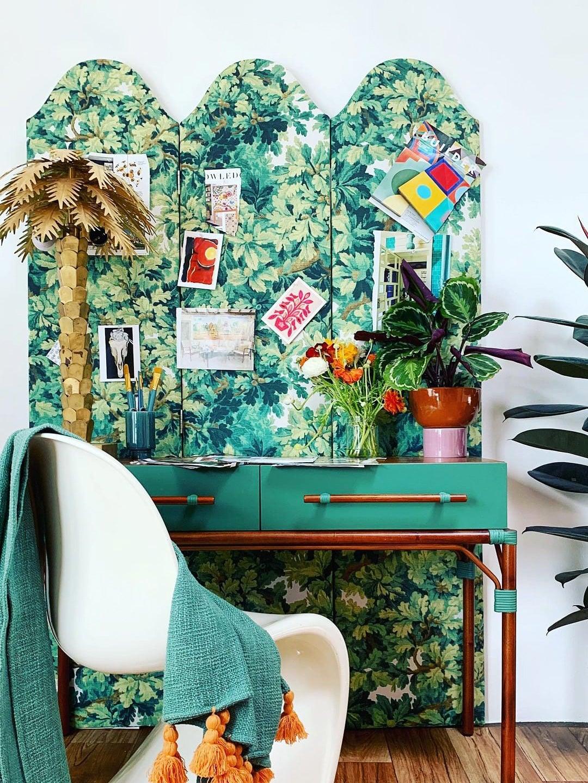 leafy botanical print screen divider behind a desk