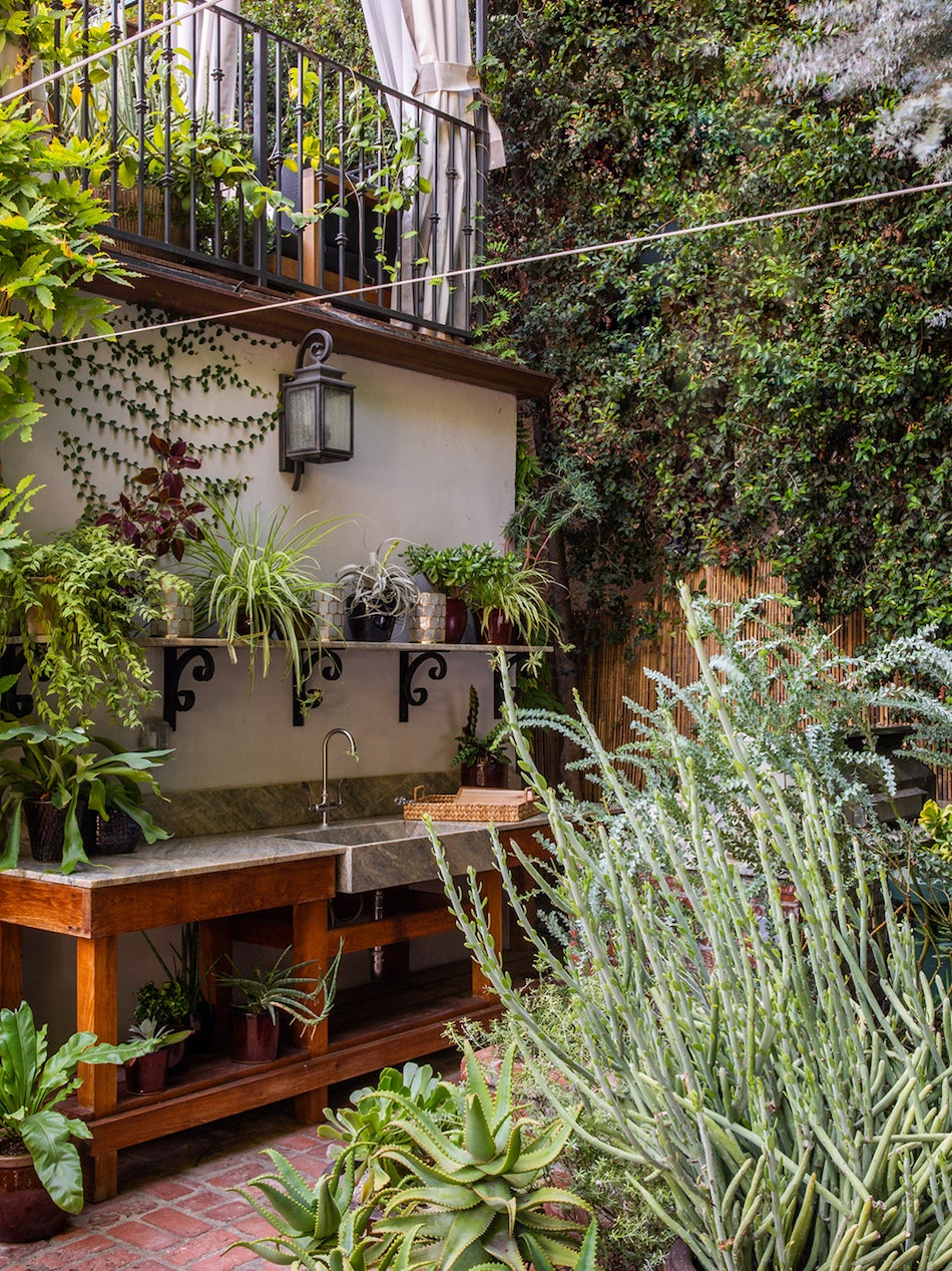 outdoor kitchen with lots of greenery