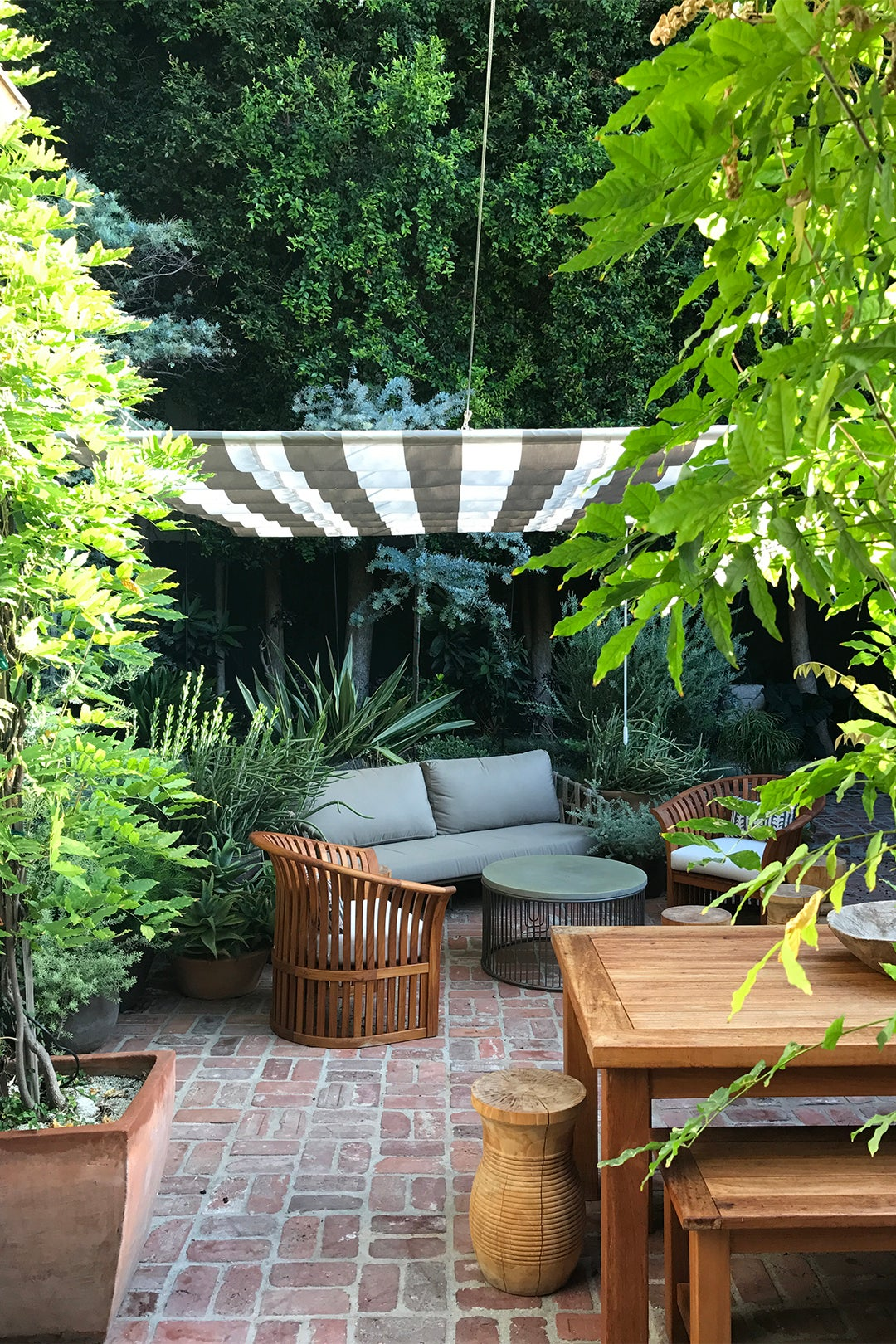 outdoor sitting area with striped canopy covering it