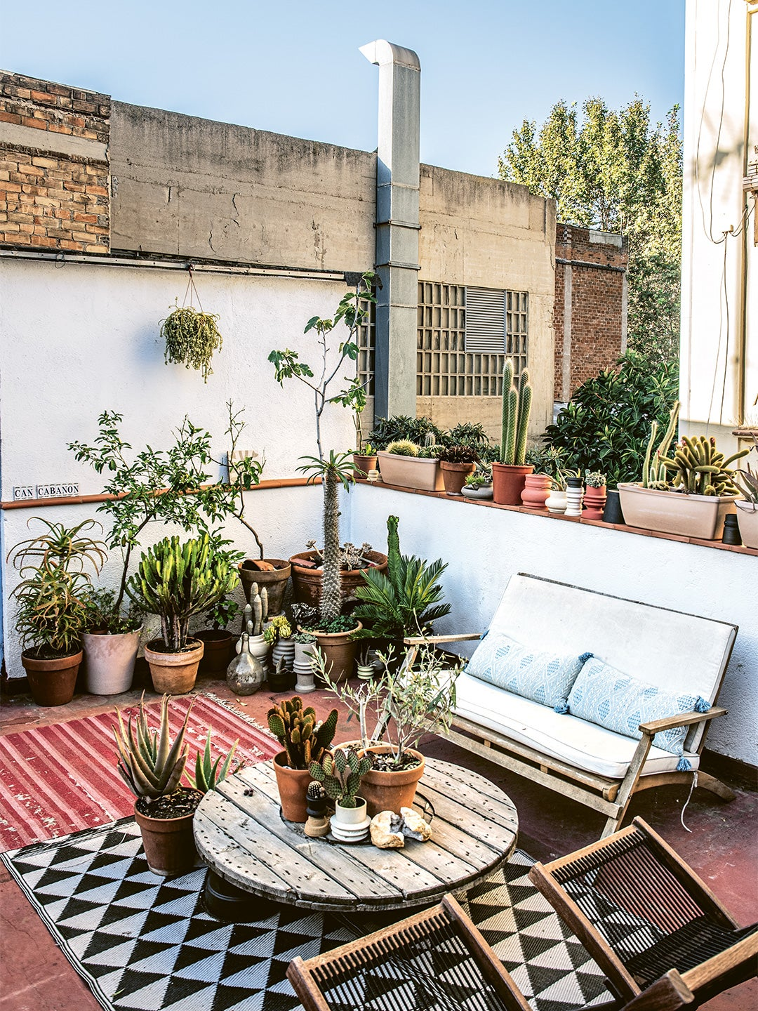 sofa and table outside on tiled patio