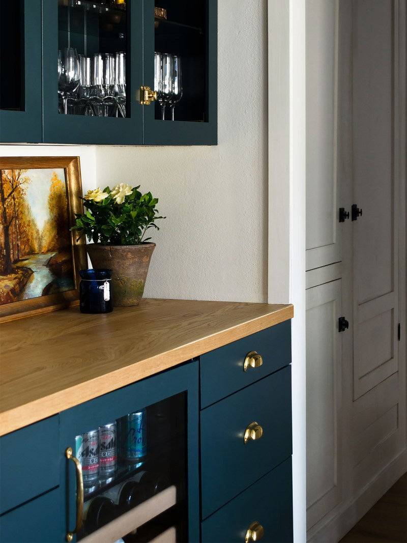 blue glass cabinets and wood counters