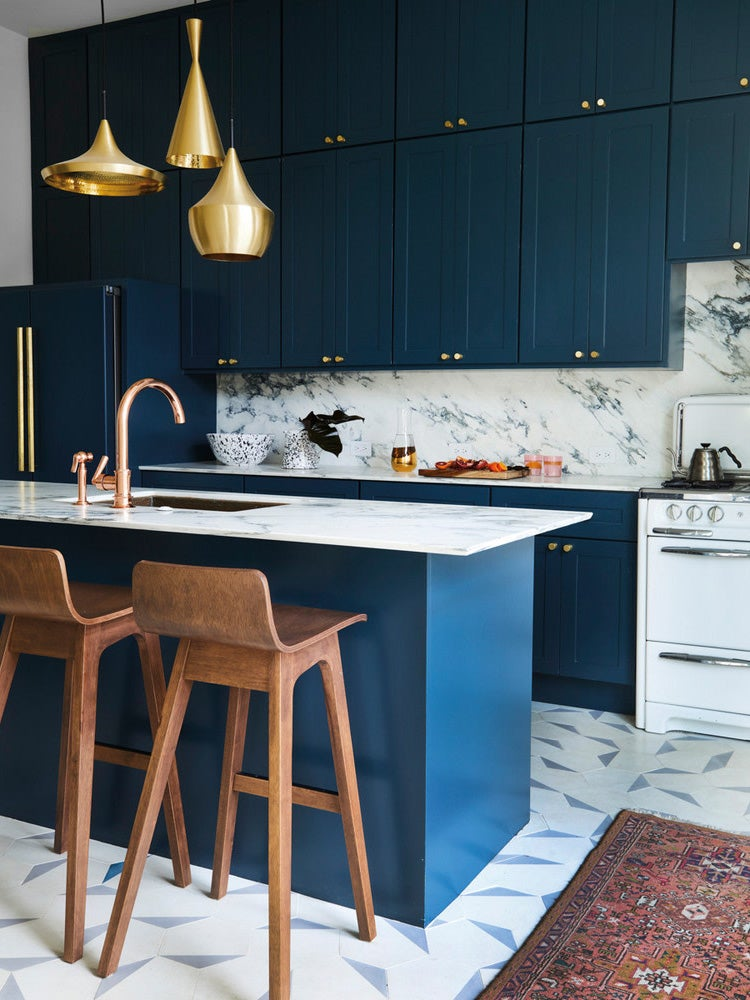 gold pendants in a blue kitchen