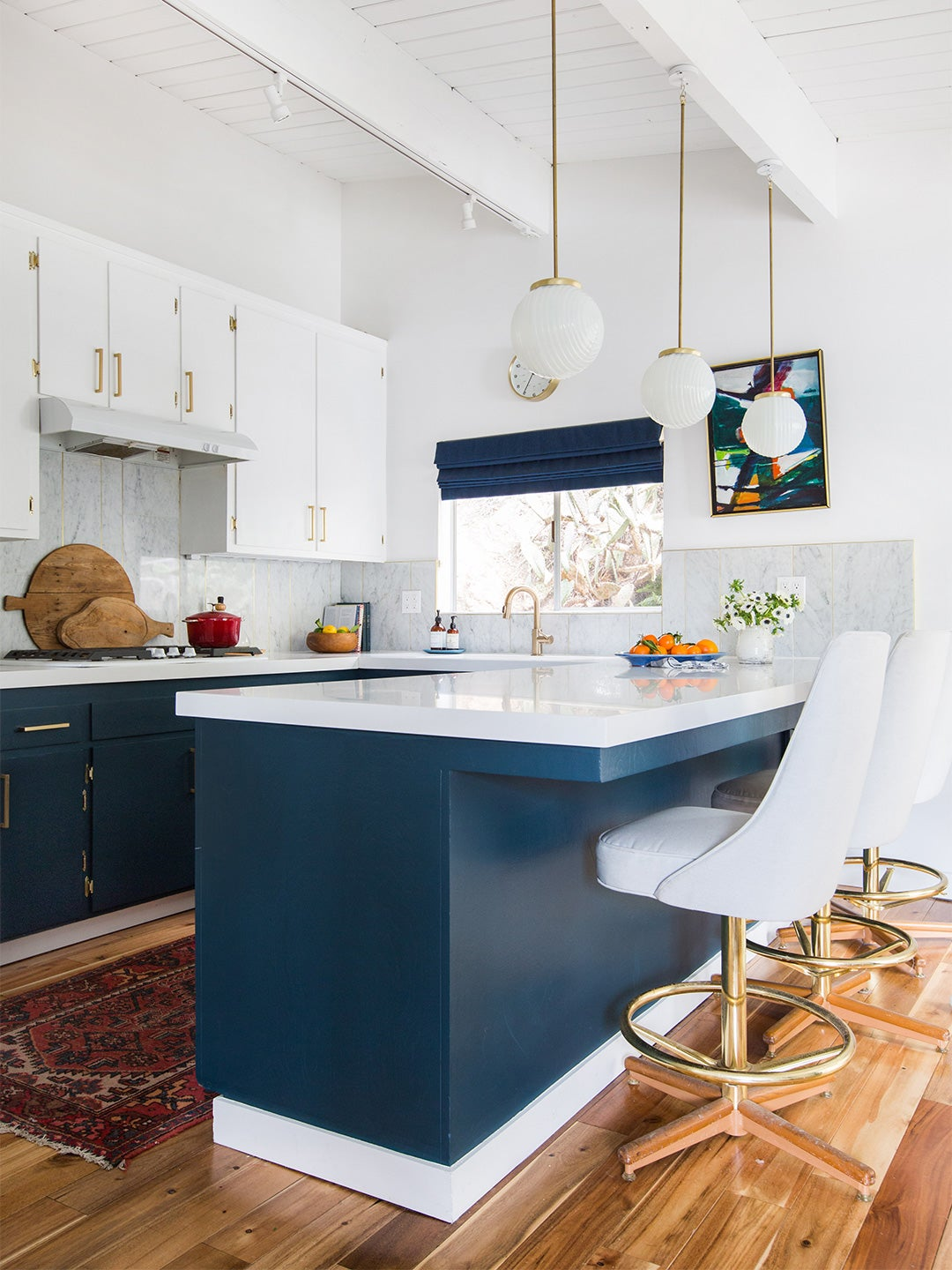 white upper and blue lower cabinets