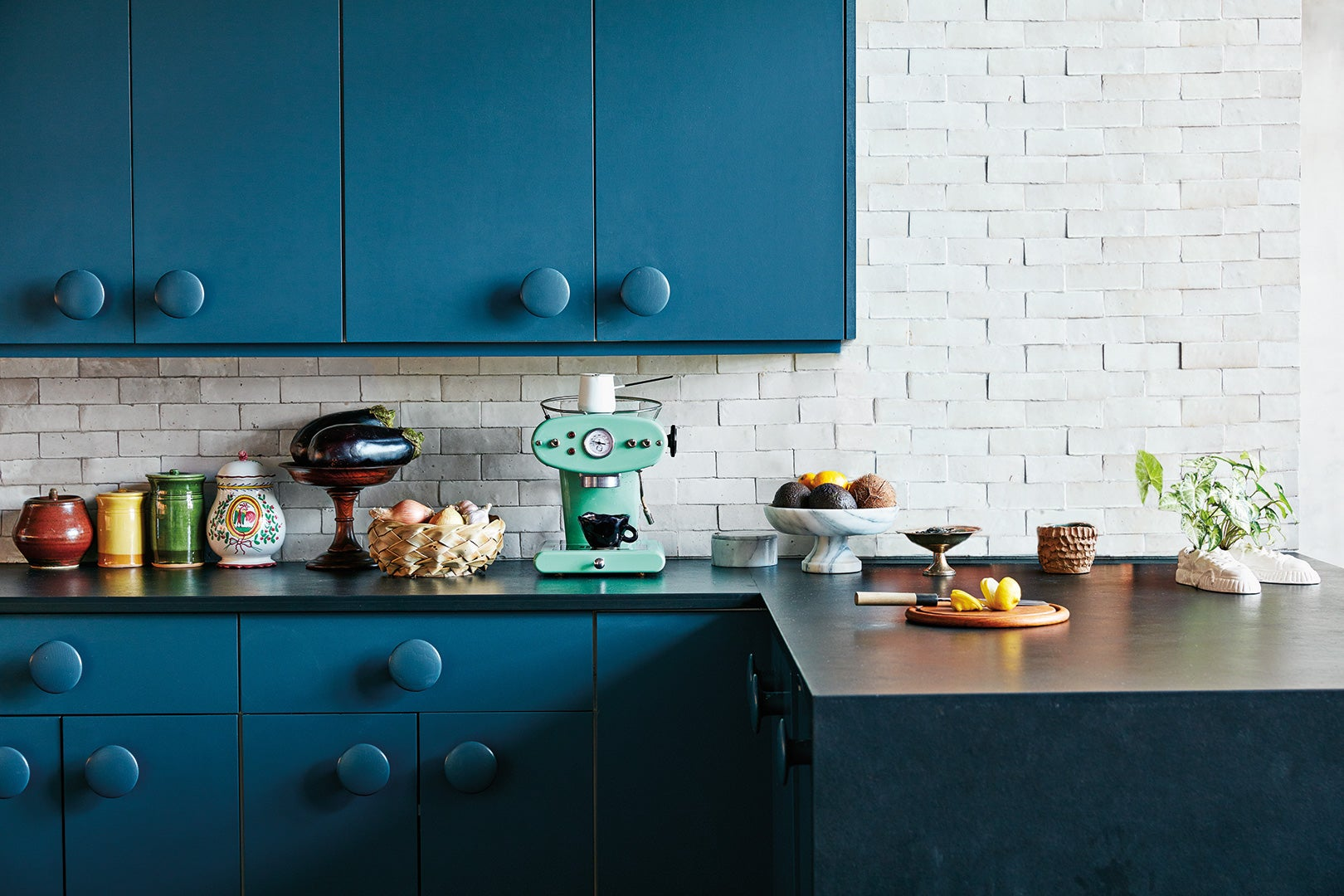 blue kitchen with blue large knobs on the doors