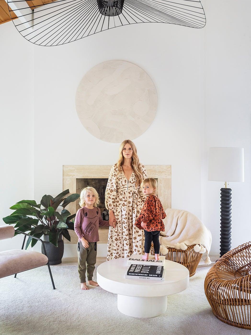Sarah sherman Samuel with kids in living room