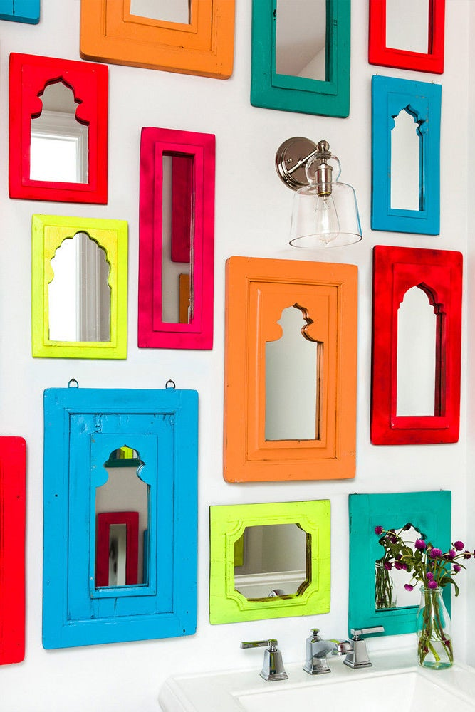 multicolored mirrors hanging on the wall