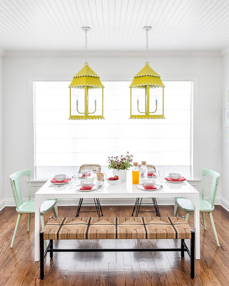 colorful breakfast nook with yellow pendant lights