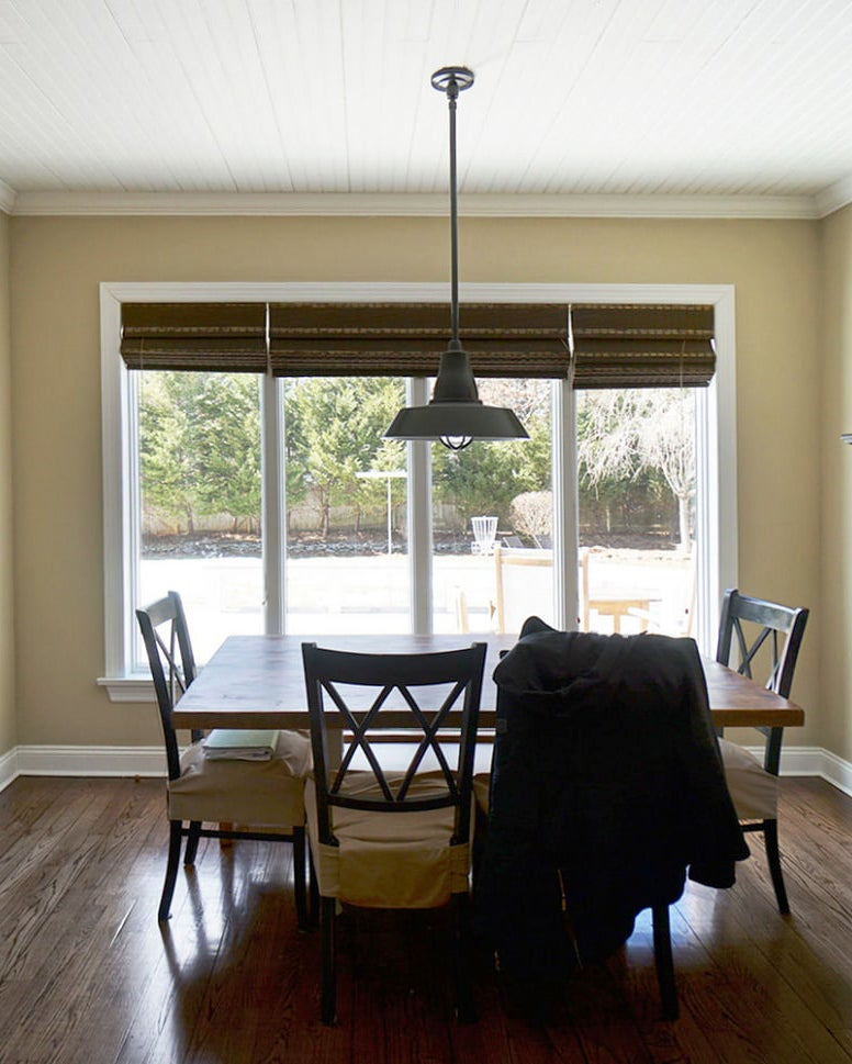 dated dining room with wood furniture