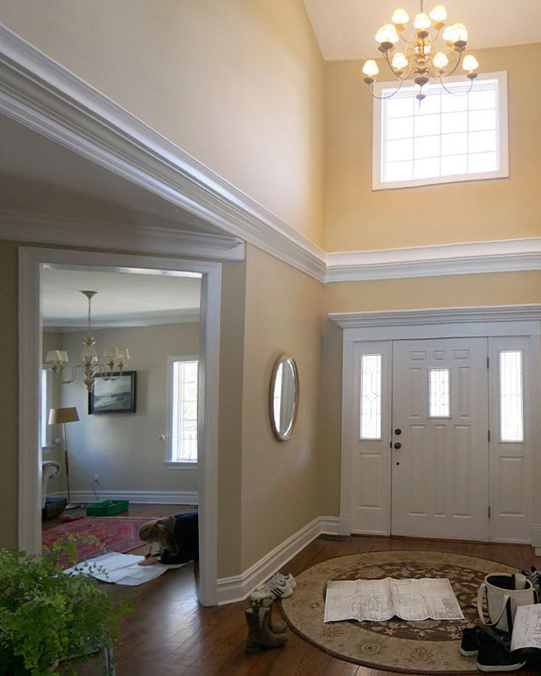 neutral colored entryway with double doors