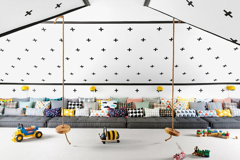 large playroom with wall decals