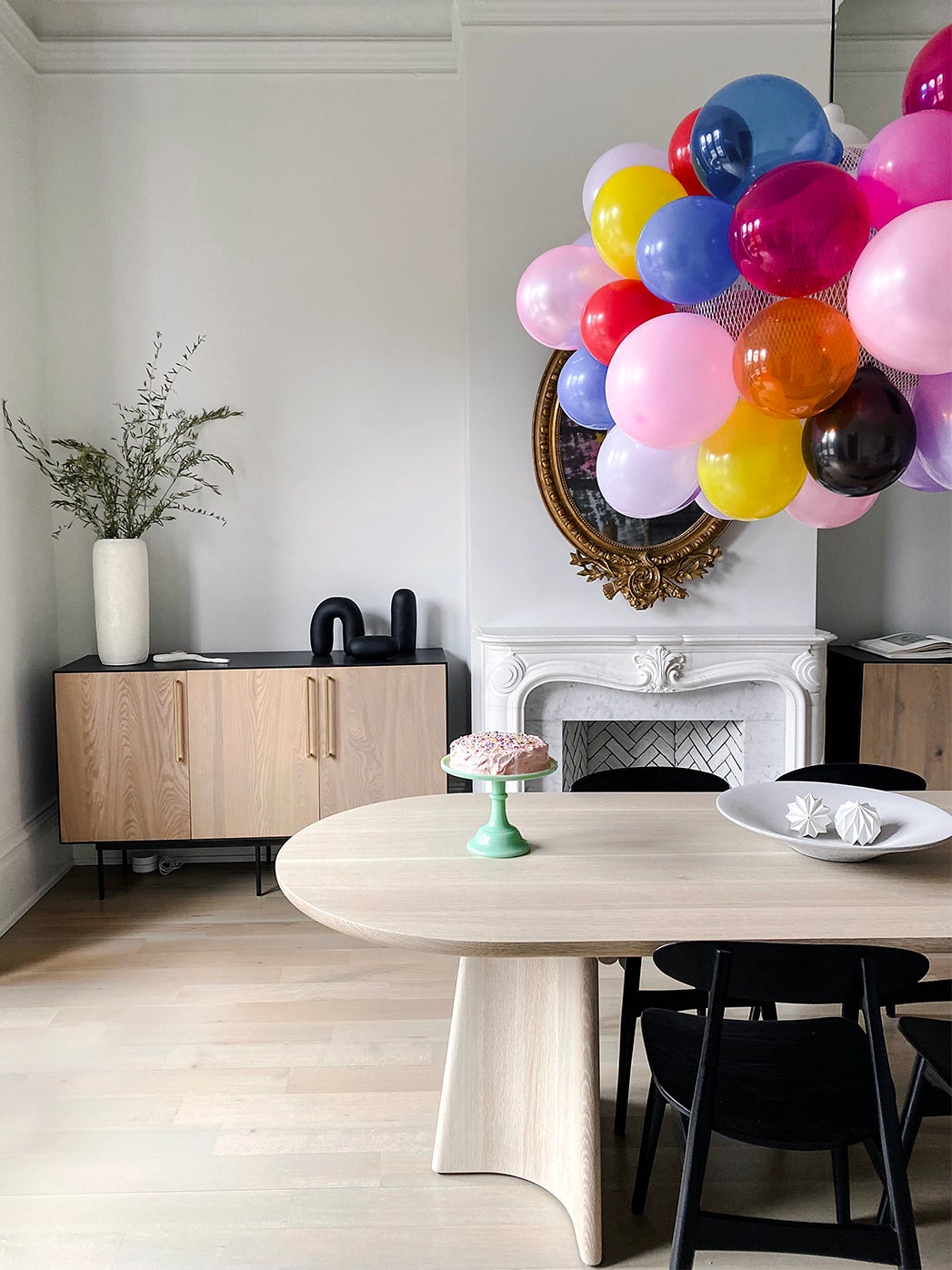dining table with balloons over it