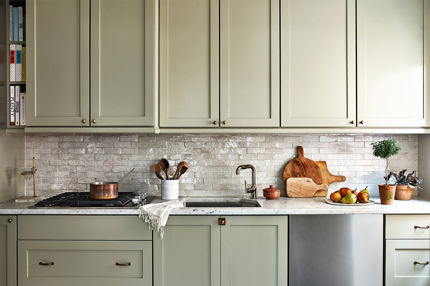 Kitchen with sage green cabinets