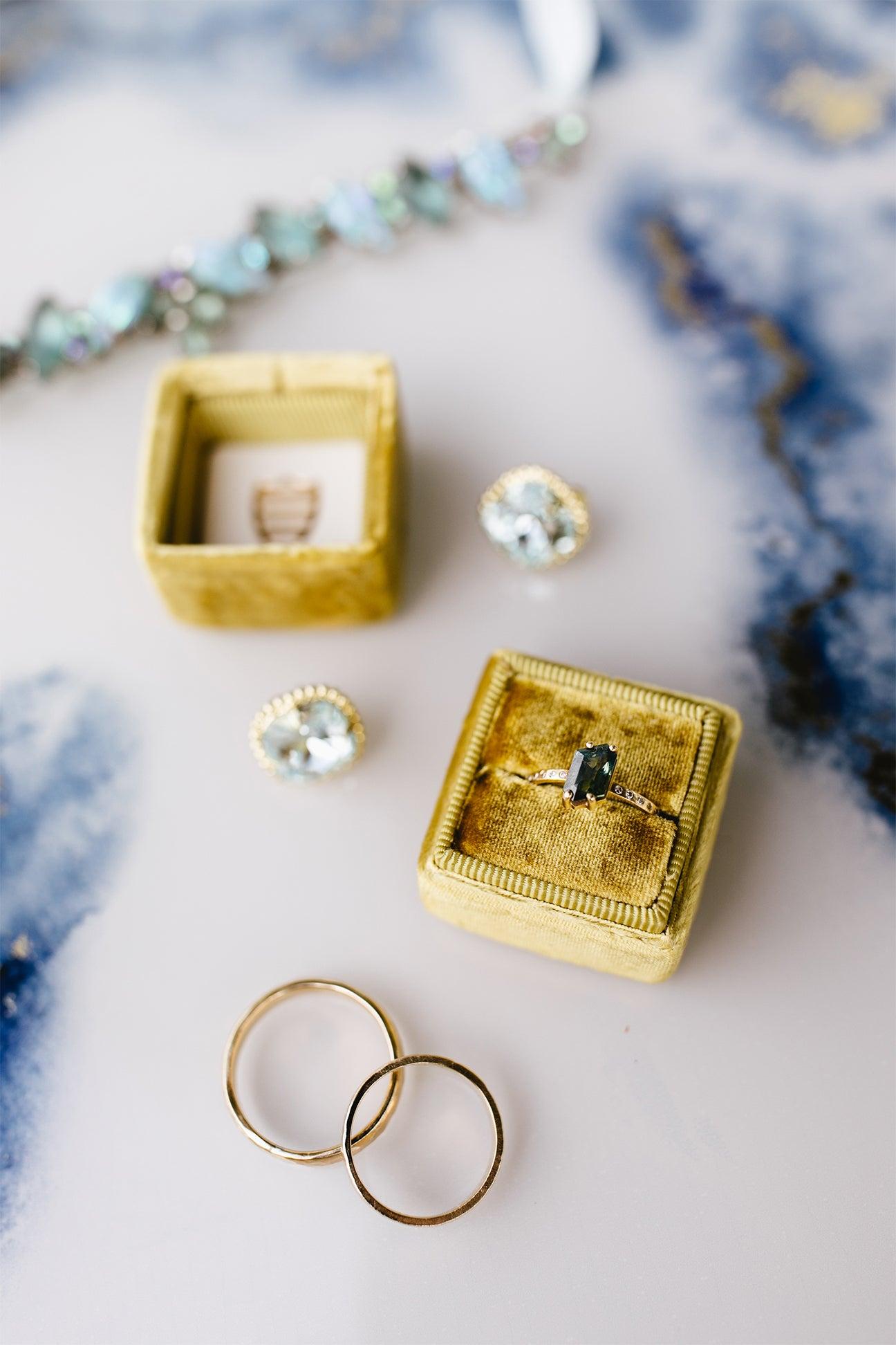 rings in yellow velvet box