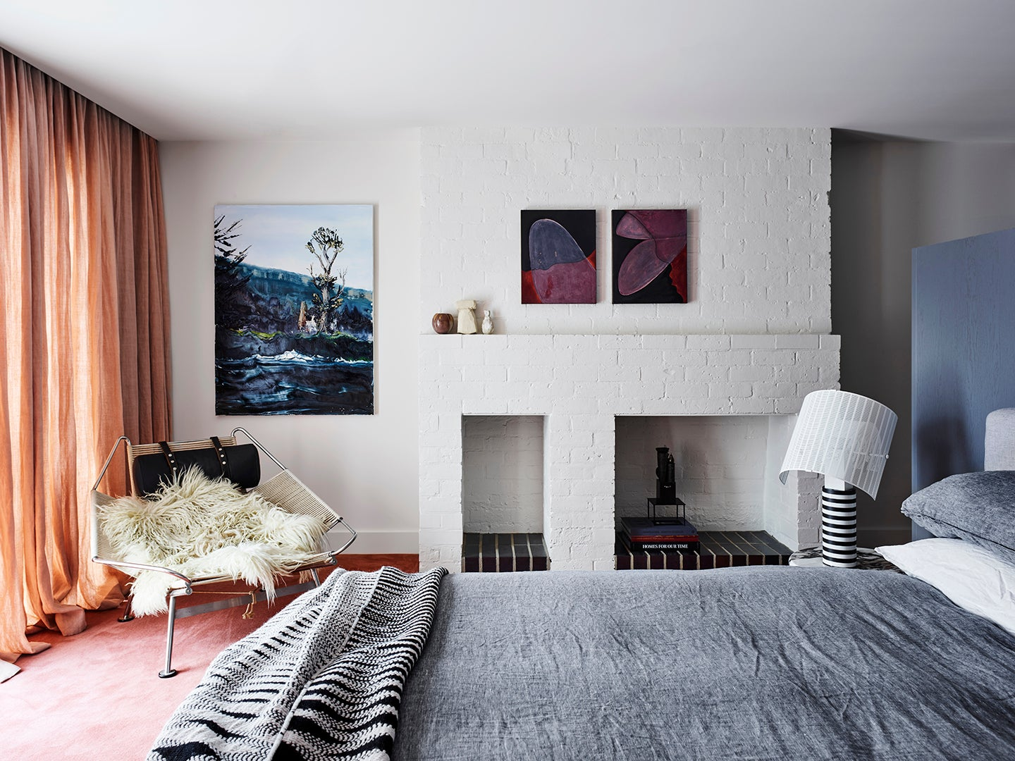 bedroom with grey bed and peach curtains
