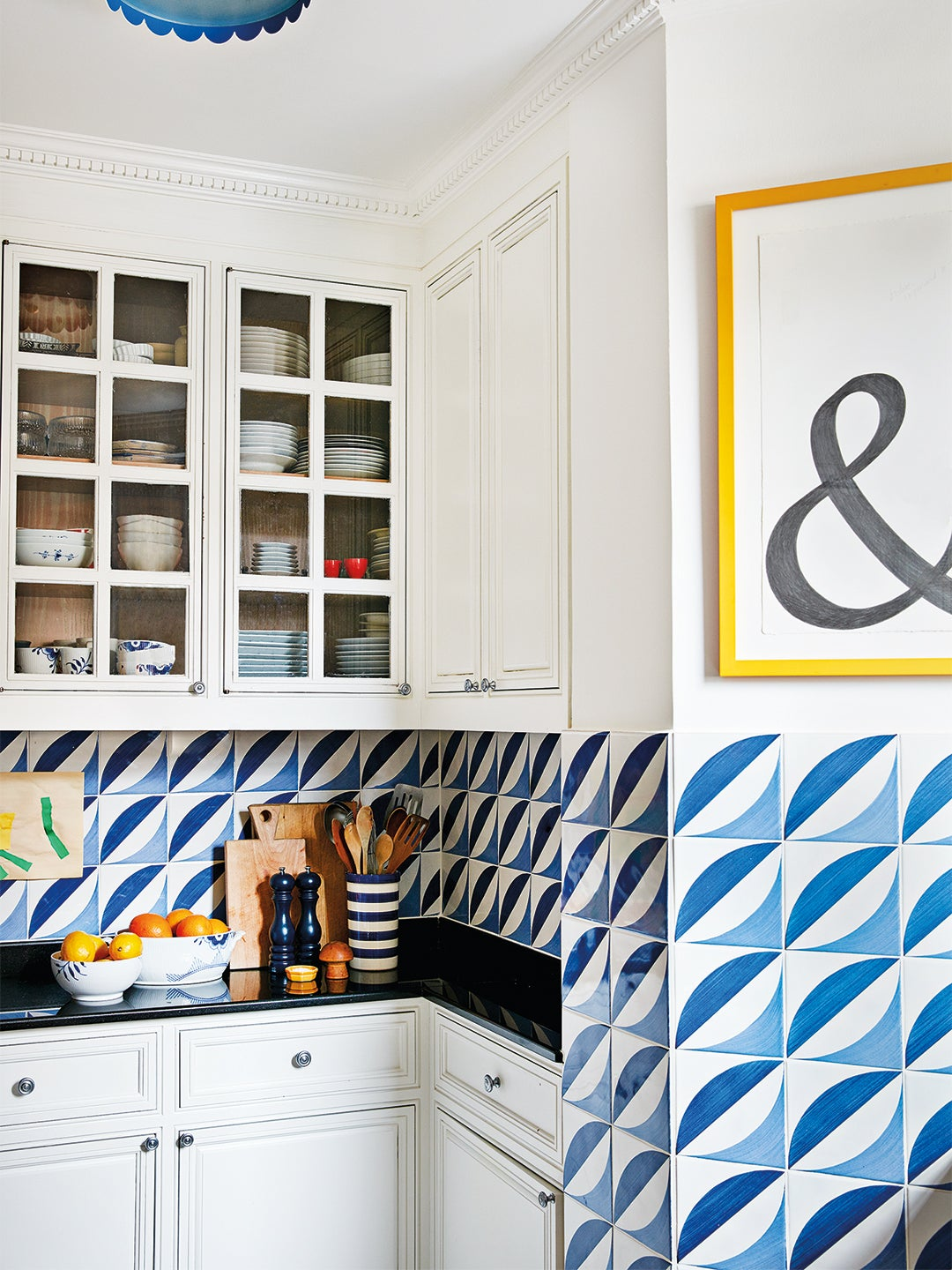 blue and white kitchen with & sign
