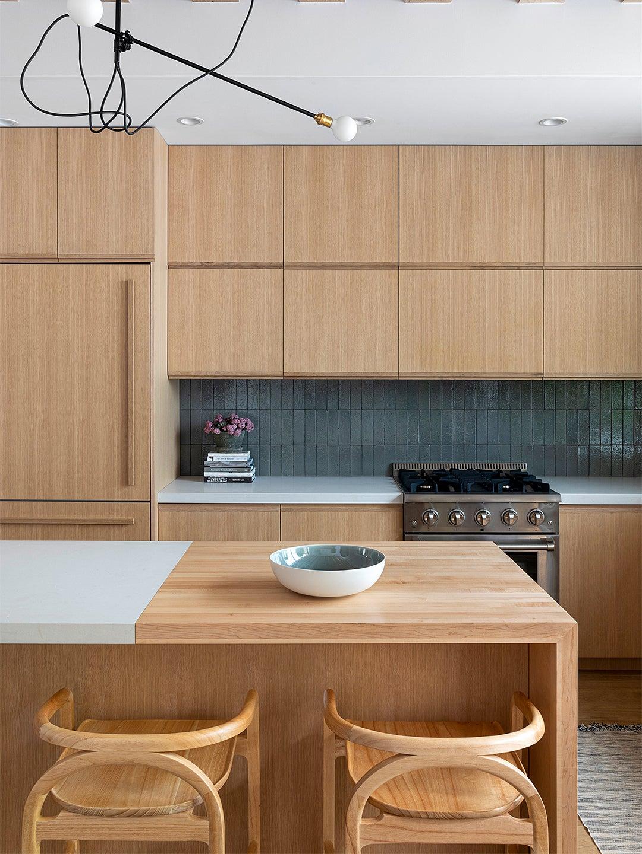 natural wood kitchen cabinets and green backsplash