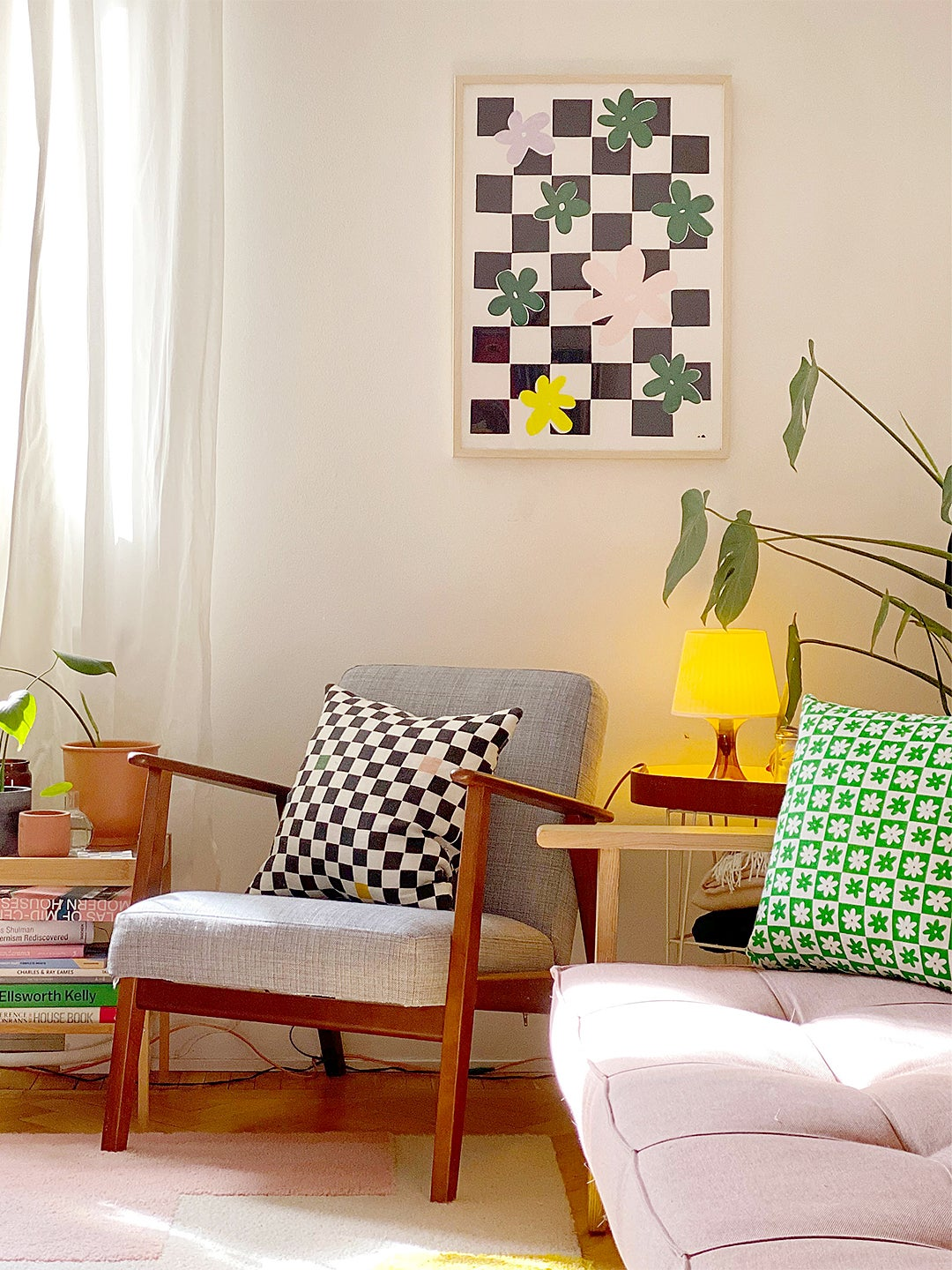 Corner of colorful living room with assorted prints