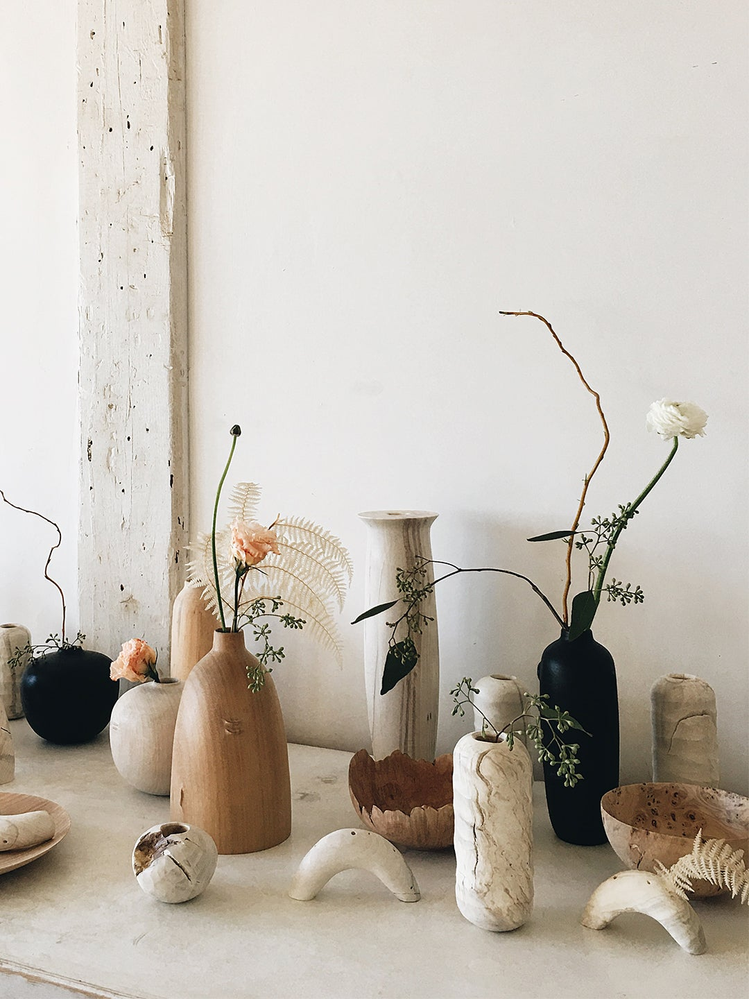 vases and other sculptural objects on a table