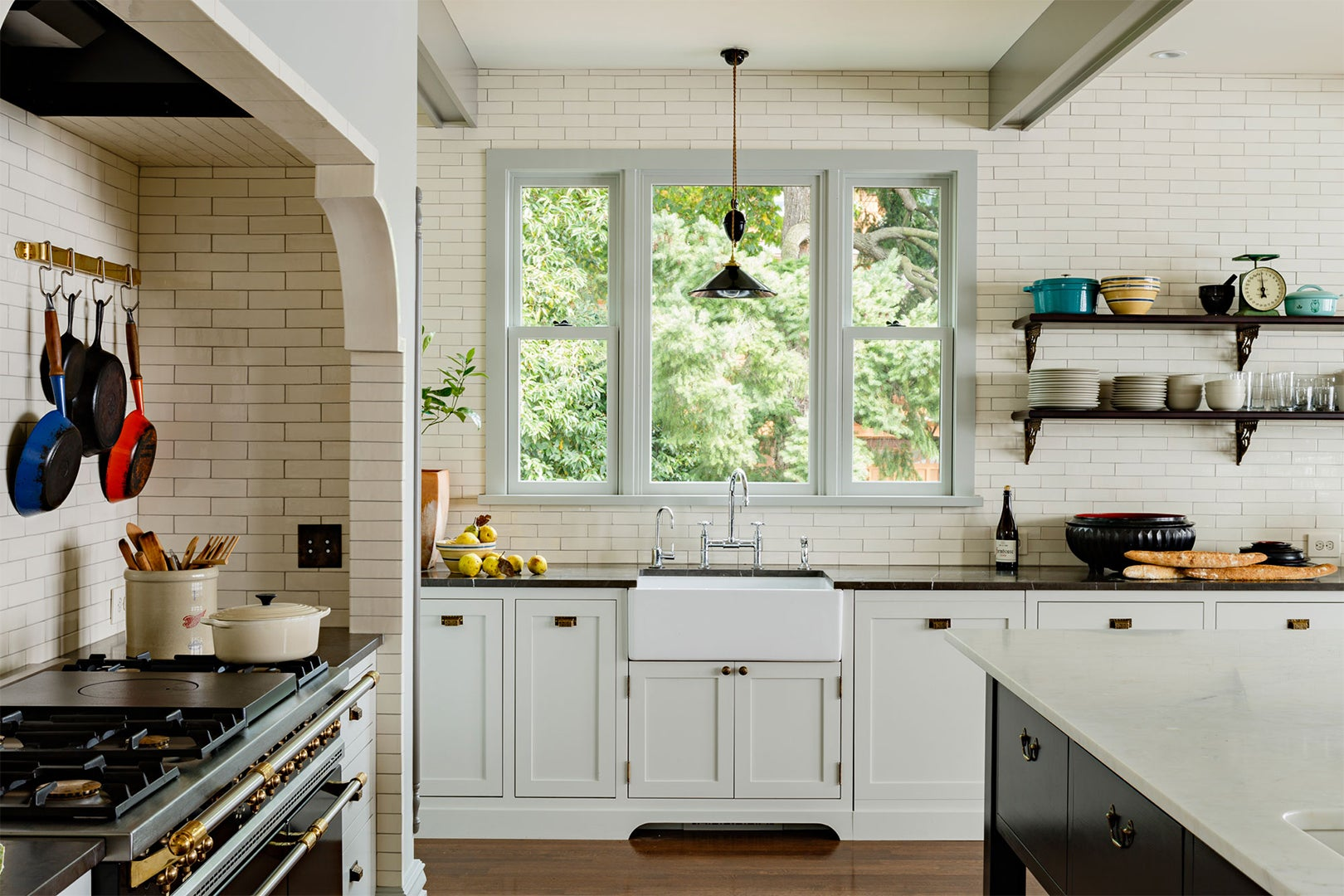 large Kitchen with farmhouse sink and modern lights