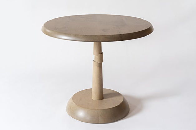 tan table with irregular leg