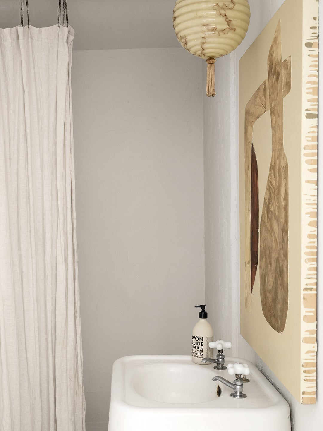 white bathroom with textured white walls