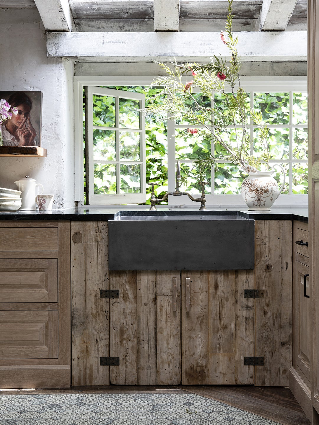 wood kitchen lower cabinets with black sink