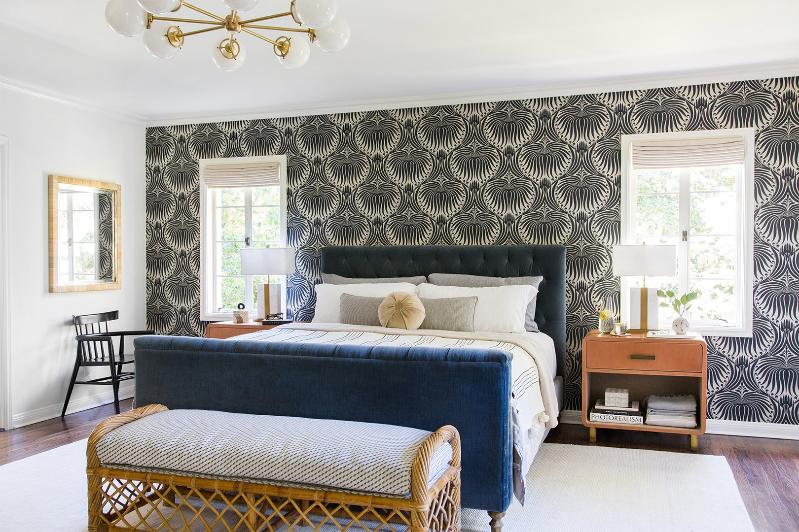 bedroom with black and white wallpaper and blue upholstered bed frame