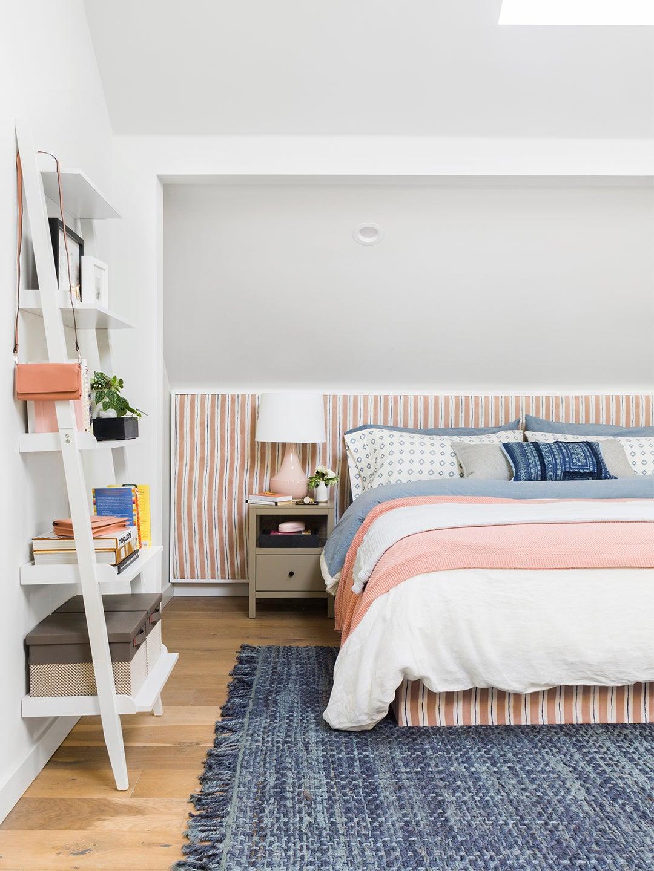 pink striped headboard in bedroom