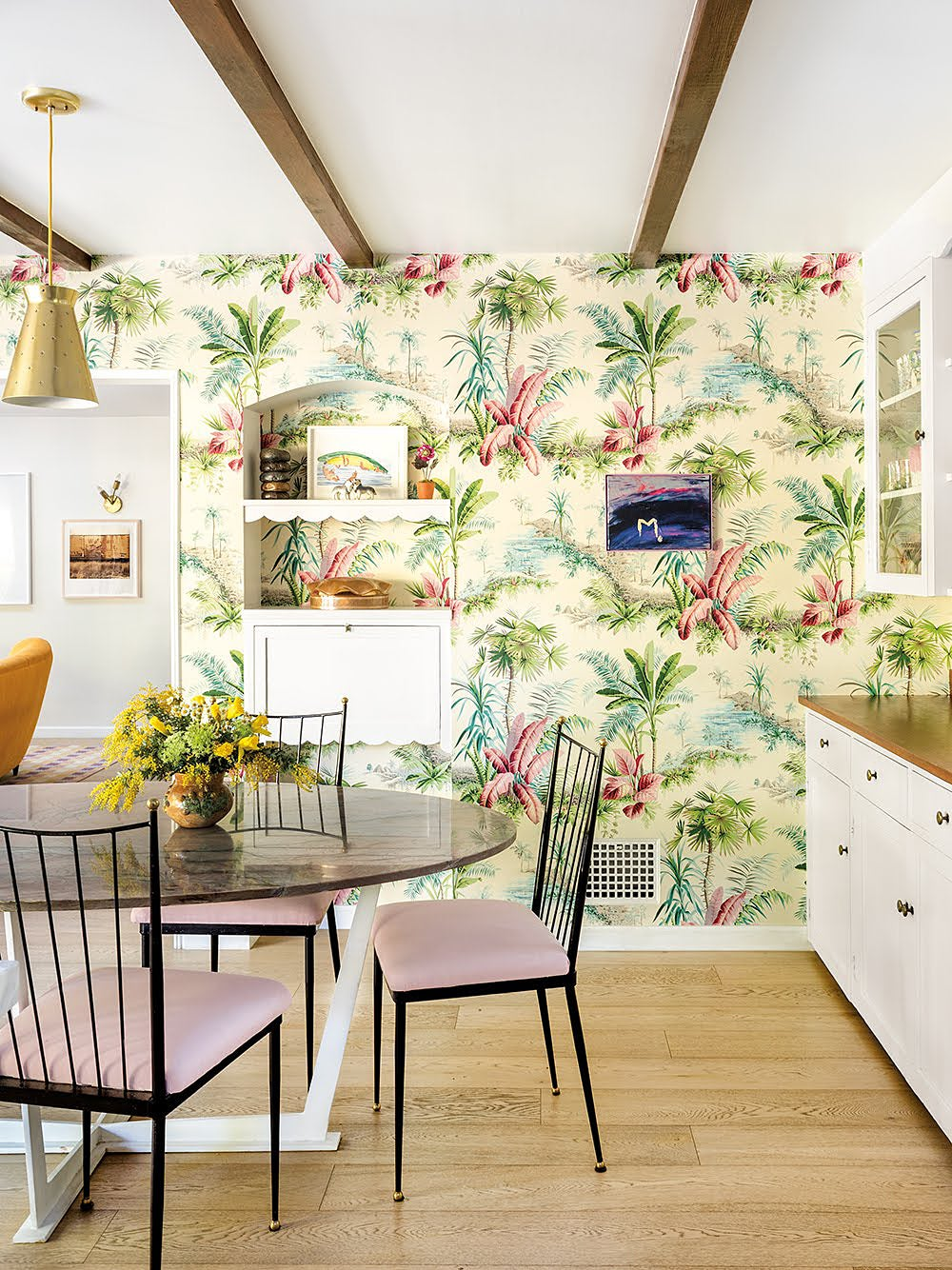 yellow tropical wallpaper in kitchen with dining nook