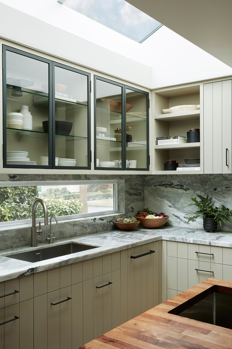 beaded cabinets in a kitchen with thin backsplash window