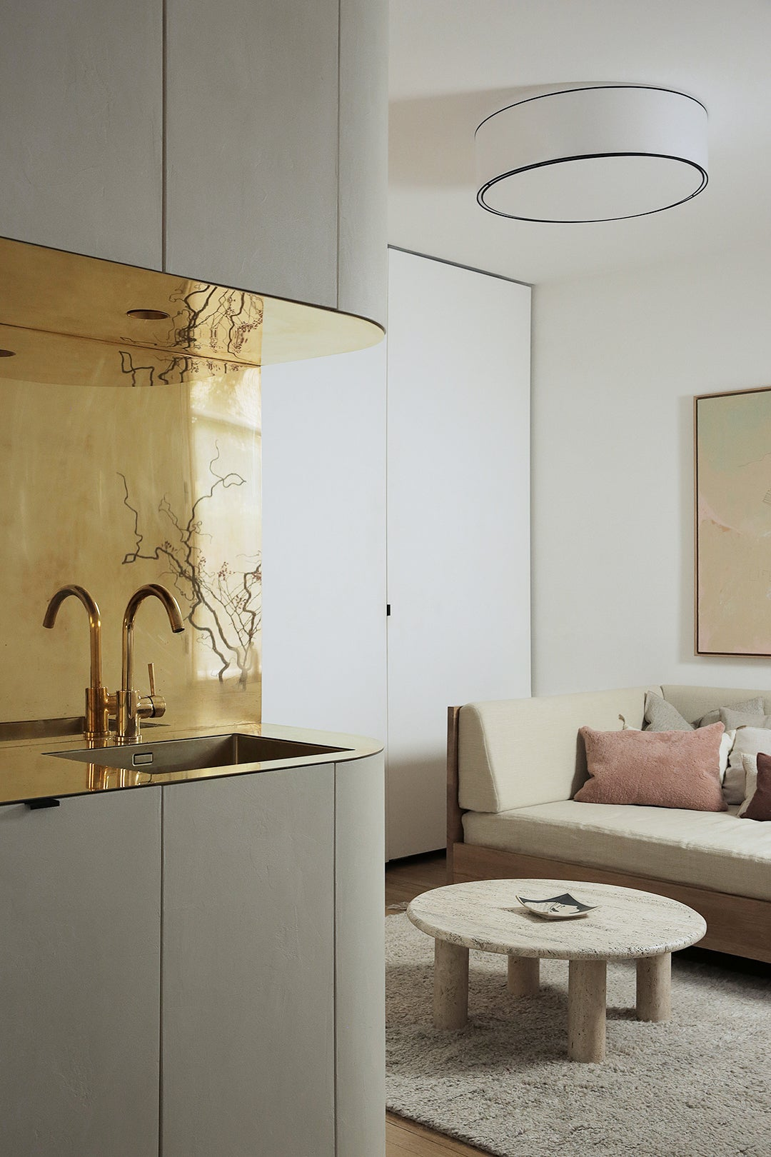 modern apartment with brass backsplash