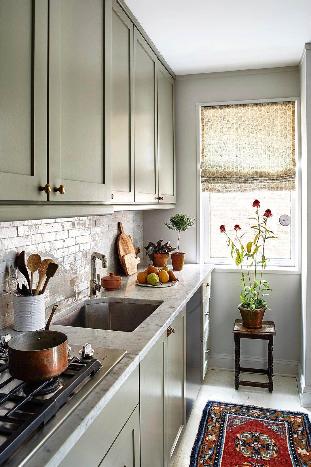 galley kitchen with oriental rug