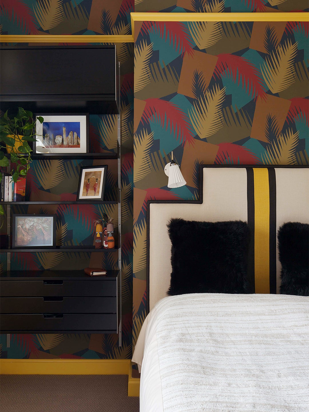multicolored accent wall in yellow guest room