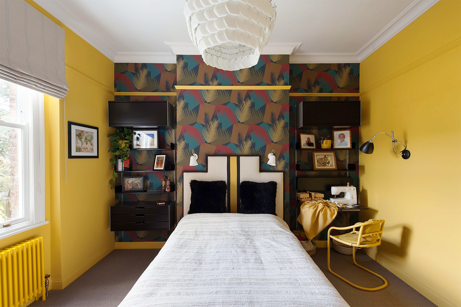 yellow guest room with sculptural pendant