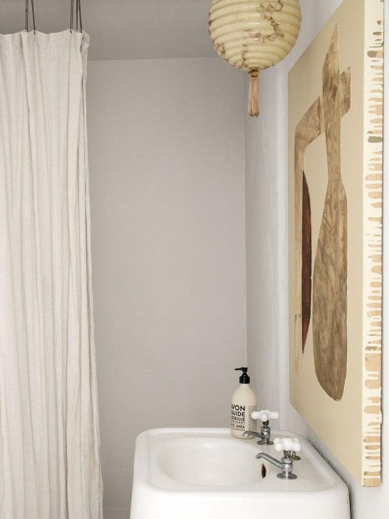 white powder room with whtie mirror
